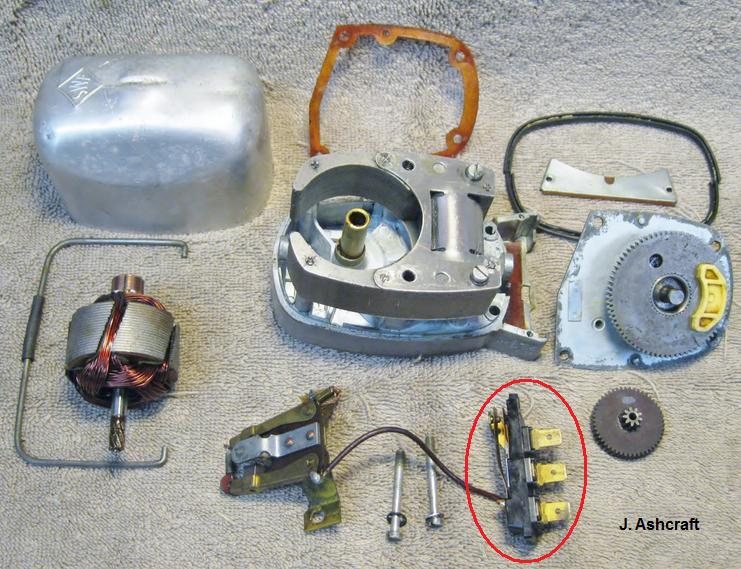 disassembled wiper motor assembly, showing major subcomponents  the yellow  eccentric (cam, 3) which actuates the park switch is apparent, as is the  park